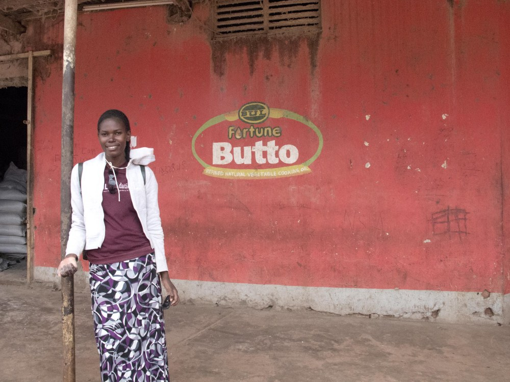 Industrial Section of Jinja: Phoebe and I get ready to barter for a better maize brand for our chicken business groups